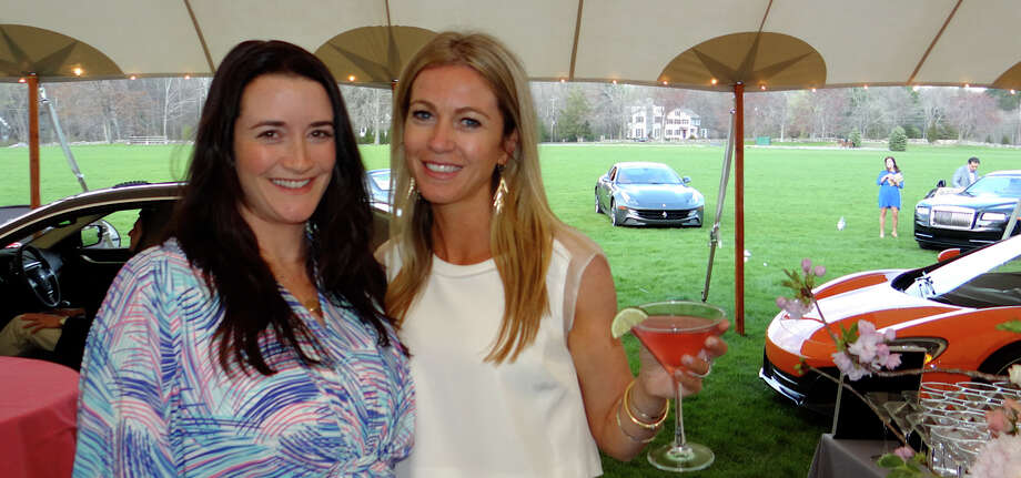 Courtney Lamoin and Kelly Scinto, co-chairwomen of Near & Far Aid's Toast the Tour cocktail reception at the Fairfield County Hunt Club on Friday evening. Photo: Mike Lauterborn / Westport News