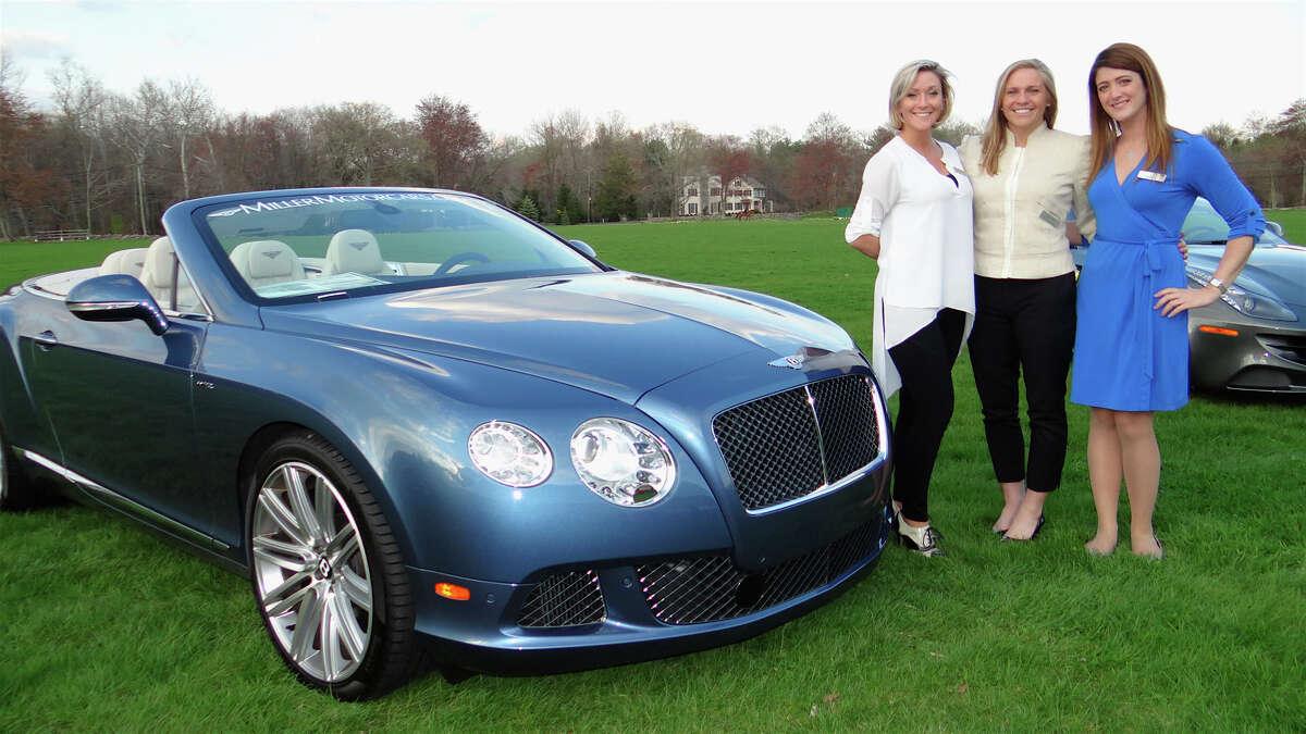 Miller Motorcars representatives Lisa Anastas, Leigh Abear and Ainsley Lothrop with a 2014 Bentley at Near & Far Aid's Toast the Tour reception at the Fairfield County Hunt Club.