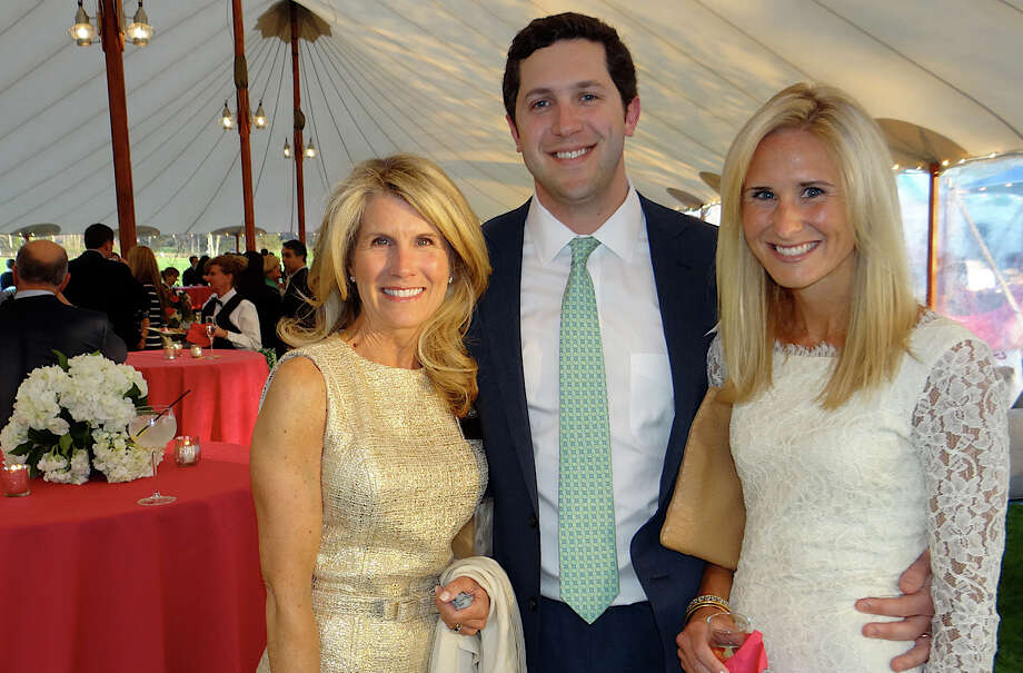 Kimberly Heyn of Southport with Rory and Hillary Budds of Fairfield at Near & Far Aid's Toast the Tour reception at the Fairfield County Hunt Club. Photo: Mike Lauterborn / Westport News
