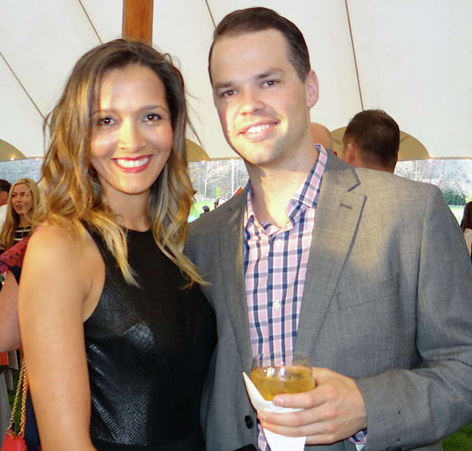 Westporters Aline Viana and Greg Gesswein at Near & Far Aid's Toast the Tour reception on Friday. Photo: Mike Lauterborn / Westport News