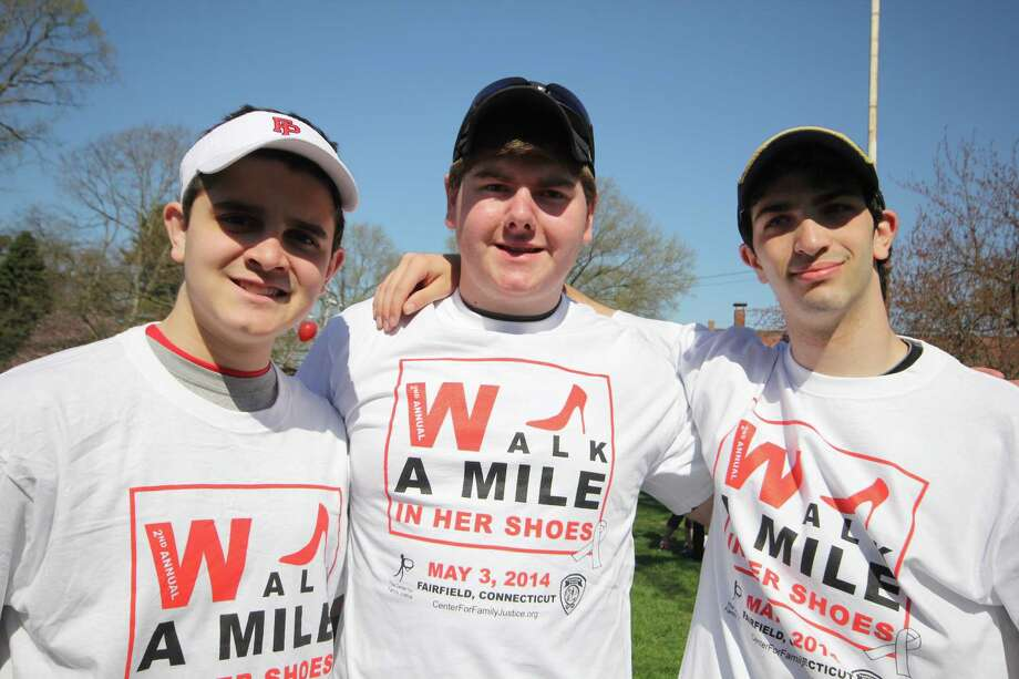 "Men walked a mile in women's shoes – literally – at the ""Walk a Mile In Her Shoes"" charity walk in downtown Fairfield on May 3. The event raised money for the Center for Family Justice in Bridgeport. Were you SEEN? Photo: Derek T.Sterling, Derek Sterling / Hearst Connecticut Media Group"