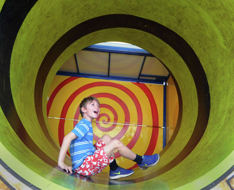"Callum Smith, 9, of Greenwich, gets rolled around in the Haunted House during the annual North Mianus School carnival and PTA fundraiser known as the ""Pow Wow, "" at the school in Greenwich, Conn., Saturday, May 3, 2014. Photo: Bob Luckey / Greenwich Time"