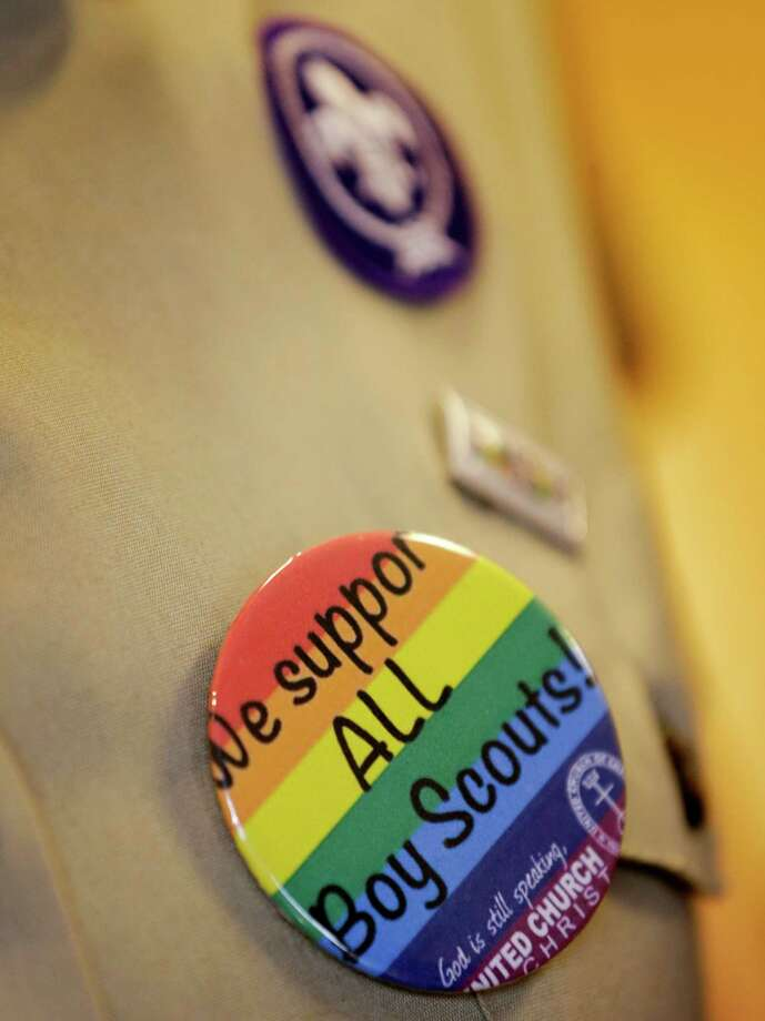 A uniform button calls on the Boy Scouts of America to end its discriminatory practices. Photo: Tony Gutierrez, STF / AP