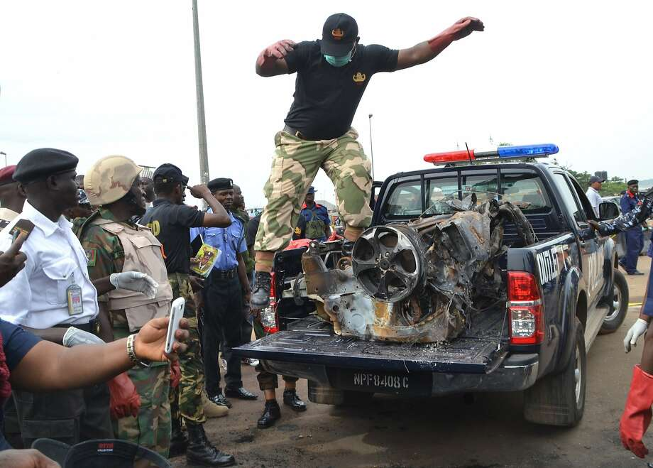Nigerian security personnel remove the wreckage of a vehicle from the site of a blast at the Nyanya bus station in the outskirts of in Abuja on May 2, 2014. At least 19 people were killed and several others injured following a bomb blast that rocked Nyanya bus station on May 1, just weeks after a deadly attack hit the same spot. No group has claimed responsibility for the latest attack, but suspicion immediately fell on Boko Haram, the extremist Islamist group which has killed thousands in a five-year insurgency. AFP PHOTO/STRINGERSTRINGER/AFP/Getty Images Photo: Stringer, AFP/Getty Images