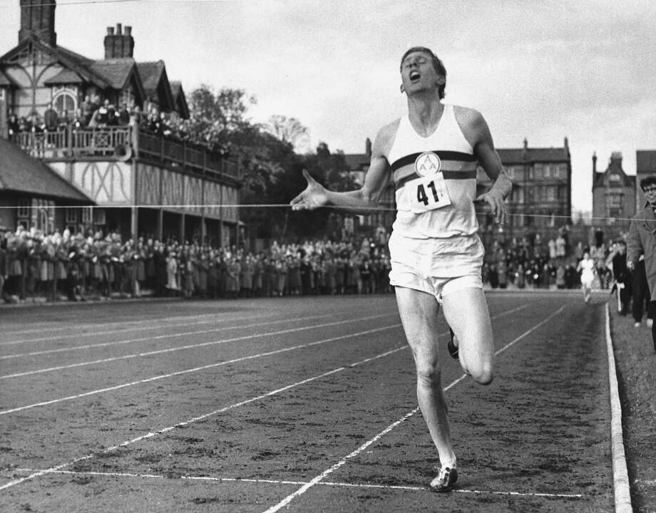 In this May 6, 1954, file photo,  British Athlete Roger Bannister breaks the tape to become the first man ever to break the four minute barrier in the mile at Iffly Field in Oxford, England.  Photo: Anonymous, Associated Press