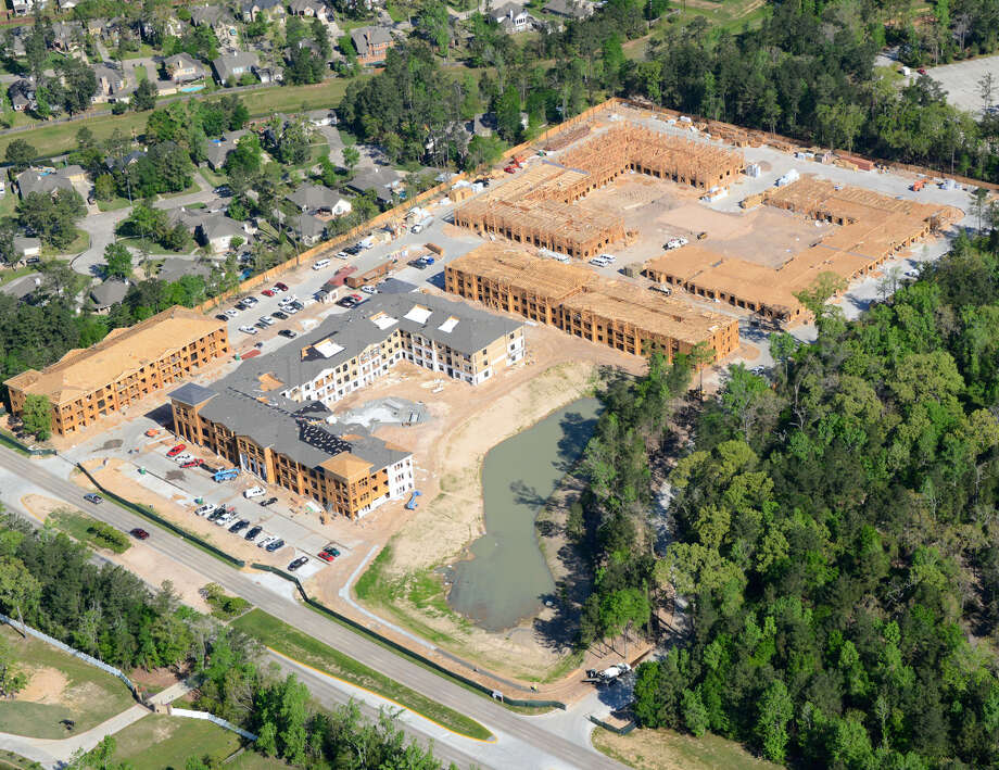 Northbrook, Ill.-based Prime Property Investors and Dallas-based Trammel Crow Residential are developing  Alexan at Auburn Lakes. The 12.5-acre gated apartment community on West Rayford and Gosling roads at the southern edge of The Woodlands consists of nine three-story buildings totaling 346 units. orthbrook, Ill.-based Prime Property Investors has announced the final topping off of its luxury garden-style apartment community in Houston called Alexan at Auburn Lakes. PPI teamed up with Dallas-based Trammel Crow Residential last fall to develop nine three-story luxury garden-style buildings for a total of 346 units. The 12.5-acre gated community is on West Rayford and Gosling roads at the southern edge of The Woodlands. Photo: Picasa / ONLINE_YES