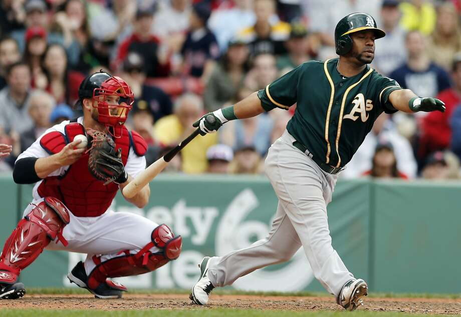 With David Ross catching Koji Uehara, the A's Alberto Callaspo strikes out in the ninth inning. Boston's Jon Lester struck out 15 A's in the first eight innings. Photo: Michael Dwyer, Associated Press