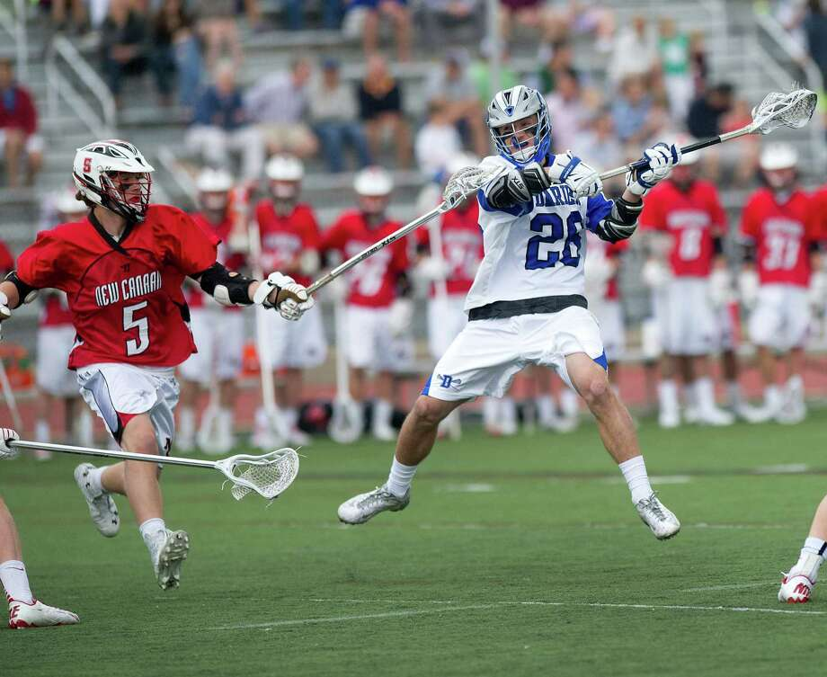 Darien's Timothy Lochtefeld takes a shot during Saturday's boys lacrosse game in Darien, Conn., on May 3, 2014. Photo: Lindsay Perry / Stamford Advocate
