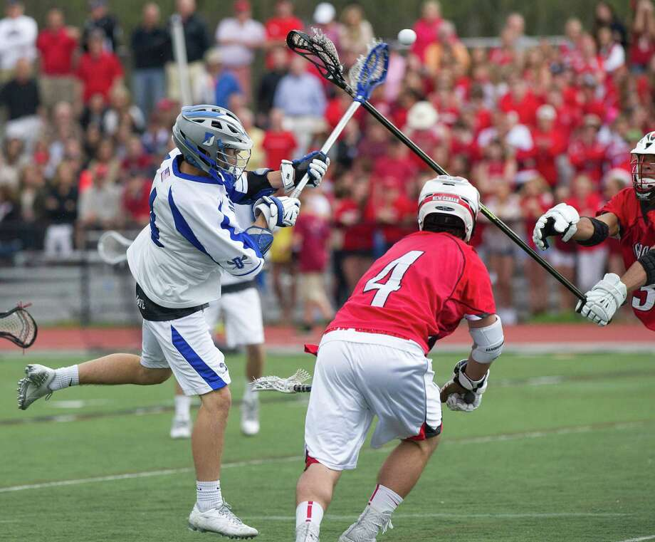 Darien's Jack Kniffin takes a shot during Saturday's boys lacrosse game in Darien, Conn., on May 3, 2014. Photo: Lindsay Perry / Stamford Advocate