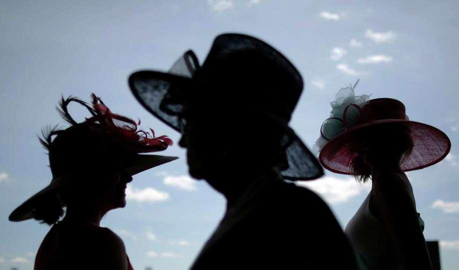 Women make their way to the grandstand. Photo: David Goldman, AP / AP