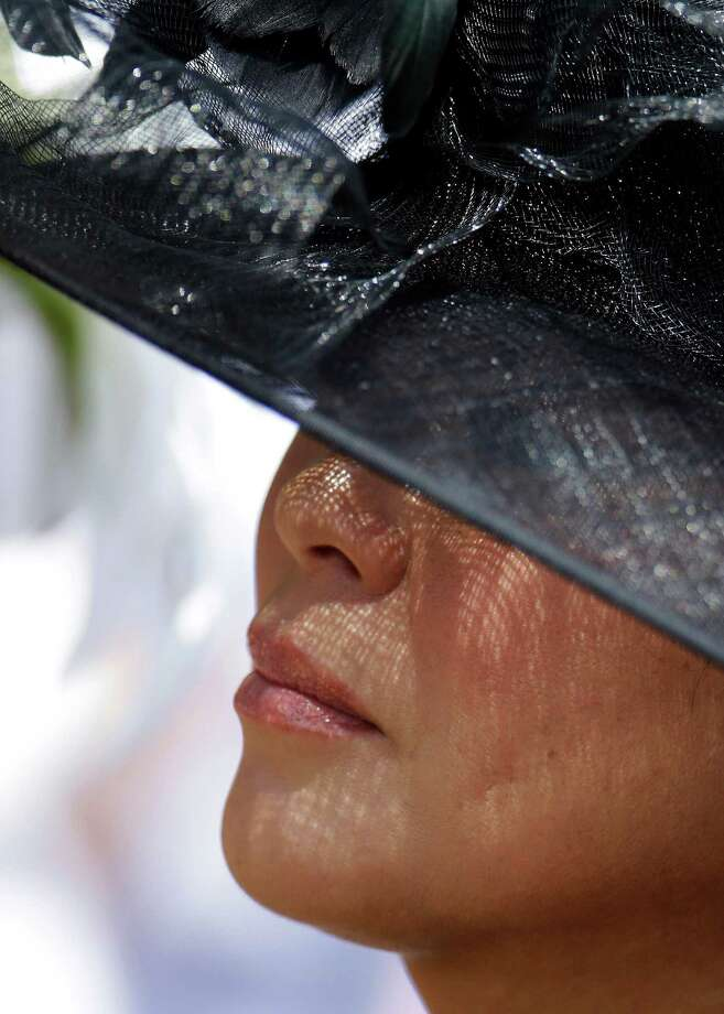 A woman watches a race. Photo: Darron Cummings, AP / AP