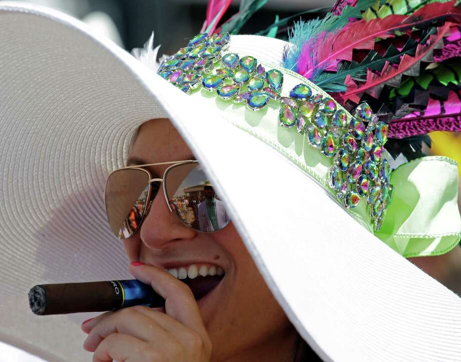 Nicole Finch smokes a cigar. Photo: David J. Phillip, AP / AP