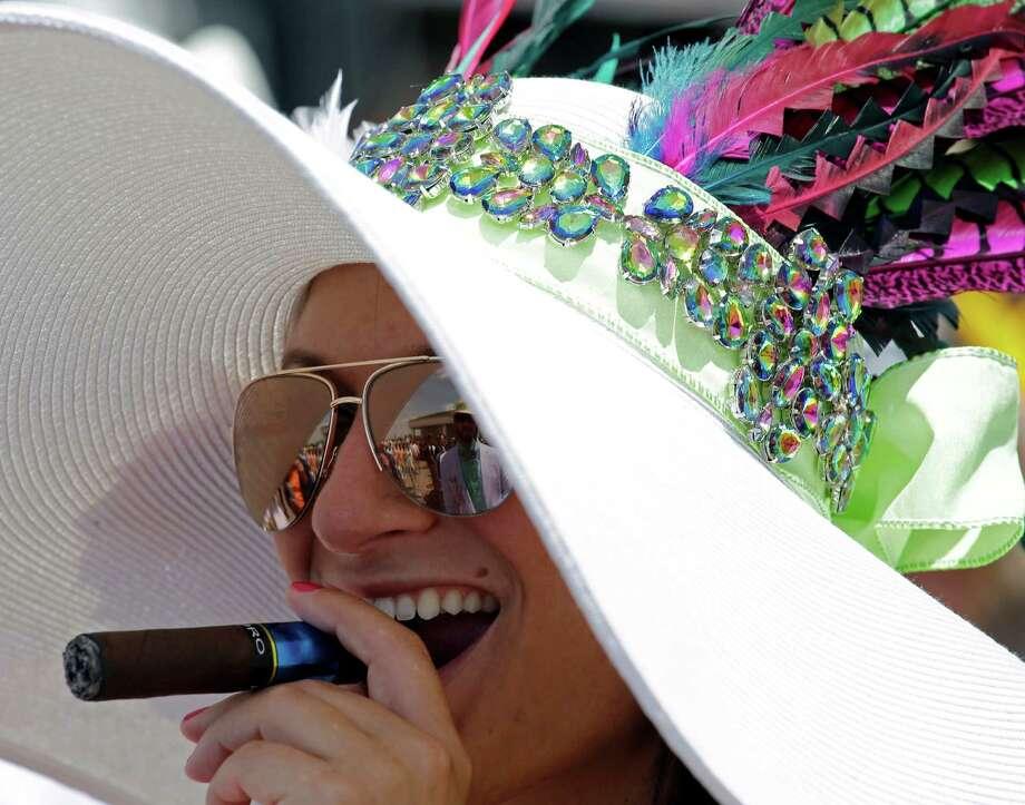 Nicole Finch smokes a cigar. Photo: David J. Phillip, AP / AP
