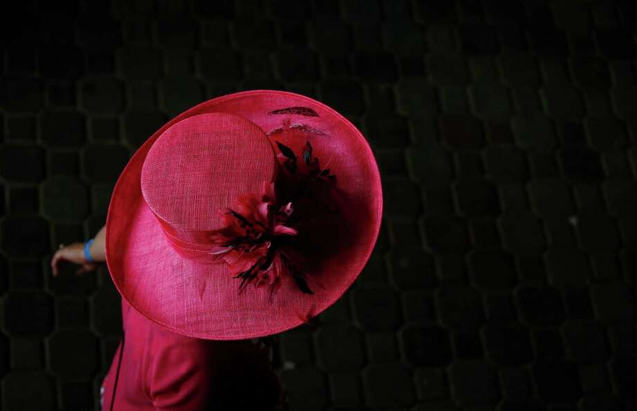 A woman makes her way to the track. Photo: Matt Slocum, AP / AP