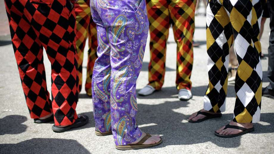 Spectators wear colorful pants. Photo: David Goldman, AP / AP2014