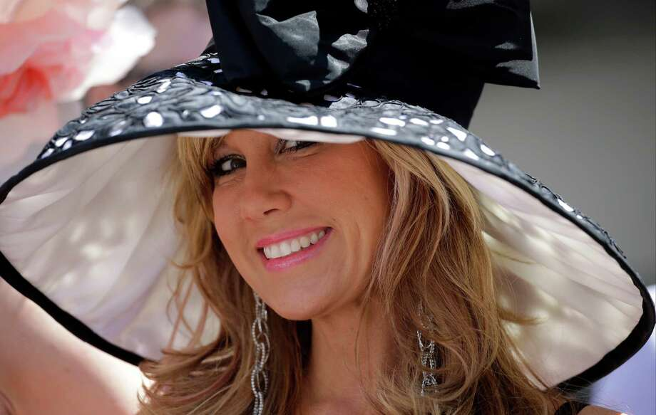 Hope Lach of Orlando, Fla., smiles before the 140th running of the Kentucky Derby at Churchill Downs in Louisville, Ky., Saturday, May 3, 2014. Photo: David J. Phillip, AP / AP2014
