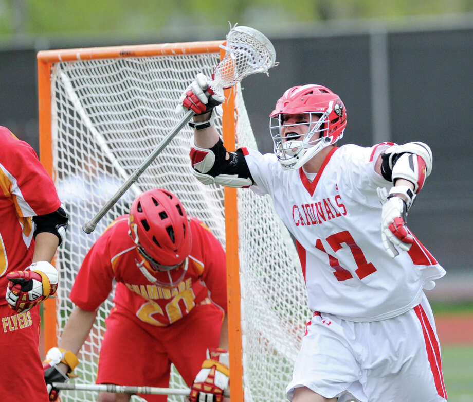 At right, Bobby Goggin (#17) of Greenwich, reacts to a goal by a teammate during the high school lacrosse match between Greenwich High School and Chaminade High School at Greenwich, Saturday, May 3, 2014. Photo: Bob Luckey / Greenwich Time