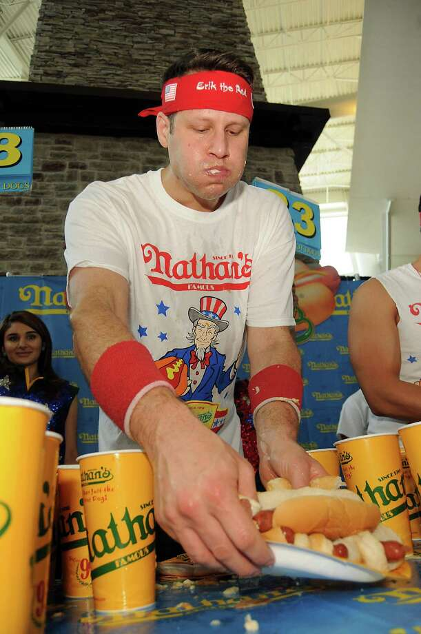 "Men's favorite Erik ""The Red"" Denmark grabs another plate of dogs at the Nathan's Famous Hot Dog Eating Contest regional qualifier at Memorial City Mall Saturday May 03, 2014. Photo: Dave Rossman, For The Houston Chronicle / © 2014 Dave Rossman"