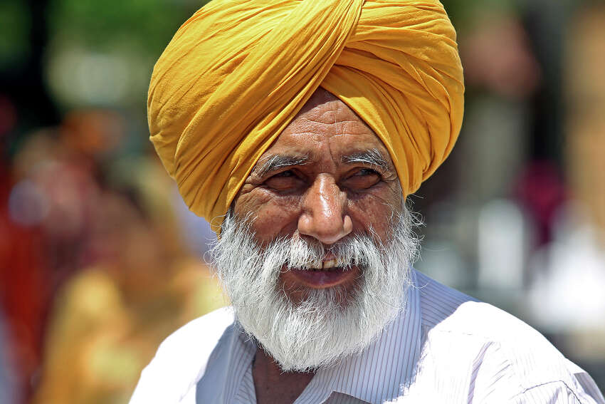 Baldev Singh Aujla walks in the crowd before the Sikh March for Peace starts at La Villita's Maverick Plaza where an event to raise money for the San Antonio Food Bank is held on May 3, 2014.