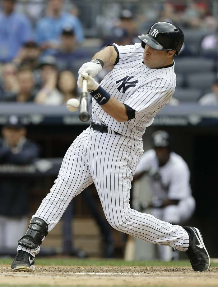 The Yankees' Mark Teixeira, who drove in three runs, belts an RBI single in the seventh inning. Photo: Frank Franklin II, Associated Press