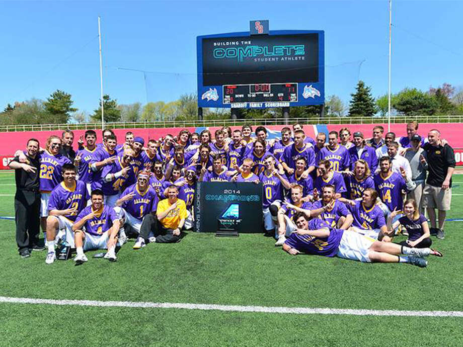 The University at Albany men's lacrosse team celebrates winning the America East championship Saturday. (Courtesy Robert O'Rourk)