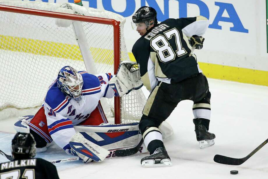 New York Rangers goalie Henrik Lundqvist (30) stops a shot by Pittsburgh Penguins' Sidney Crosby (87) in the first period of Game 1 of a second-round NHL hockey playoff series in Pittsburgh, Friday, May 2, 2014. (AP Photo/Gene J. Puskar) ORG XMIT: PAGP103 Photo: Gene J. Puskar / AP
