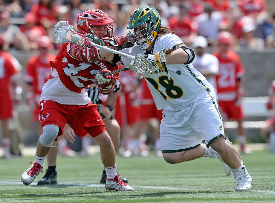 Siena midfielder Casey Dowd goes around a defender Saturday in the MAAC men's lacrosse championship game. (Dave Anderson) / DAVE ANDERSON