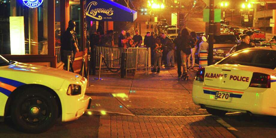 Looking north on North Pearl Street from Columbia Street early Saturday, May 3, 2014, between two Albany police cars parked near the nightclub Legends on Pearl, which attracts crowds late on weekend nights. (Photo by Steve Barnes/Times Union.)