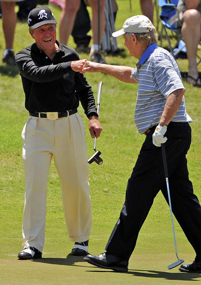 Gary Player, left, fist bumps playing partner Jack Nicklaus after Player made birdie on No. 3 during the Greats of Golf competition at the Insperity Championship, Saturday, May 3, 2014, at The Woodlands Country Club Tournament Course in The Woodlands. Photo: Eric Christian Smith, For The Chronicle