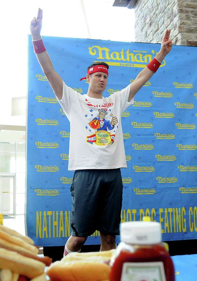 "Mens favorite Erik ""The Red"" Denmark takes the stage at the Nathan's Famous Hot Dog Eating Contest regional qualifier at Memorial City Mall Saturday May 03, 2014.(Dave Rossman photo) Photo: Dave Rossman, For The Houston Chronicle / © 2014 Dave Rossman"
