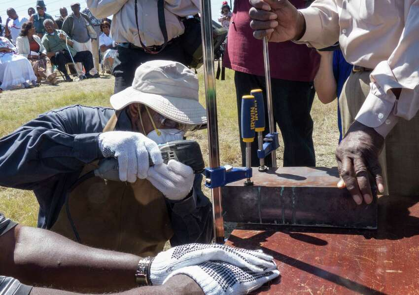 A time capsule recovered from the burned remains of the old Childress Memorial Church of God in Dignowity Hill is opened during the groundbreaking ceremony at the church's new location on Binz-Engelman on Saturday, May 3, 2014. The capsule dates to 1908.