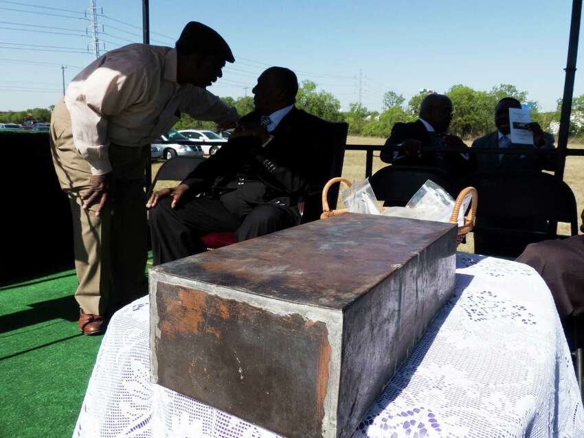 A time capsule recovered from the burned remains of the old Childress Memorial Church of God in Dignowity Hill sits by dignitaries before the groundbreaking ceremony at the church's new location on Binz-Engelman on Saturday, May 3, 2014. The capsule dates to 1908.