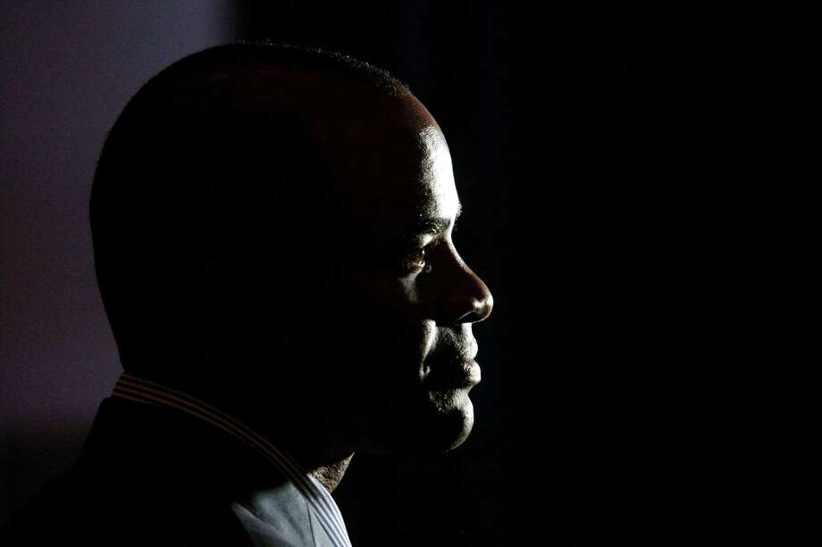 Texans general manager Rick Smith would rather not have earned the No. 1 overall pick, but he expects the team to be much-improved after this week. Photo: Billy Smith II, Staff / © 2013 Houston Chronicle