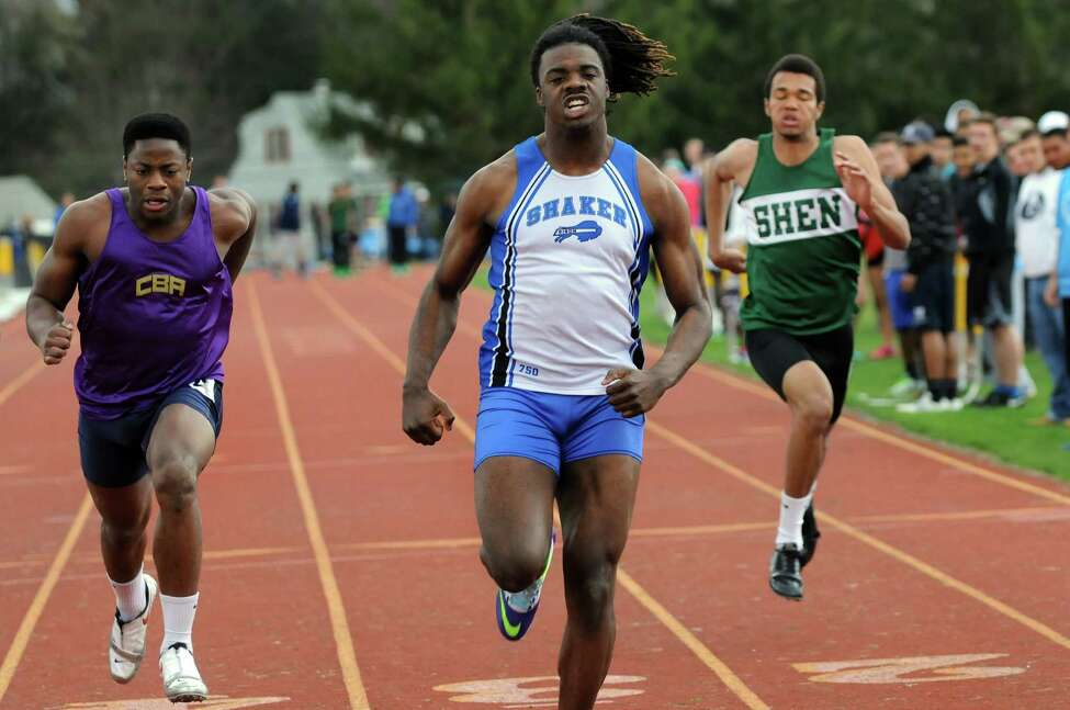 Shaker's Lloyd Smalling, center, on his way to winning the 100-meter dash during a track meet on Saturday, May 3, 2014, at Colonie High School in Colonie, N.Y. (Cindy Schultz / Times Union)