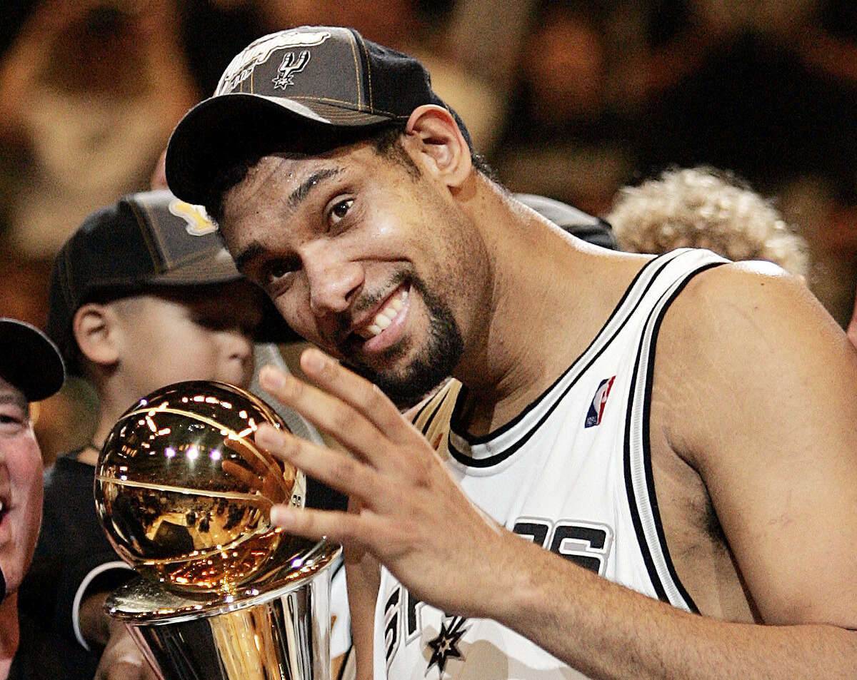 For all of the San Antonio fans who miss watching their favorite basketball team, the Spurs are hosting a watch party at the AT&T Center next week to relive the team's 2005 NBA Championship win. In the photo, Tim Duncan is seen celebrating the win.