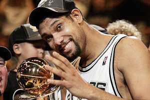 Tim Duncan celebrates as he was named the MVP of the NBA Finals for a third time when the Spurs won the NBA title in 2005 against the Pistons.