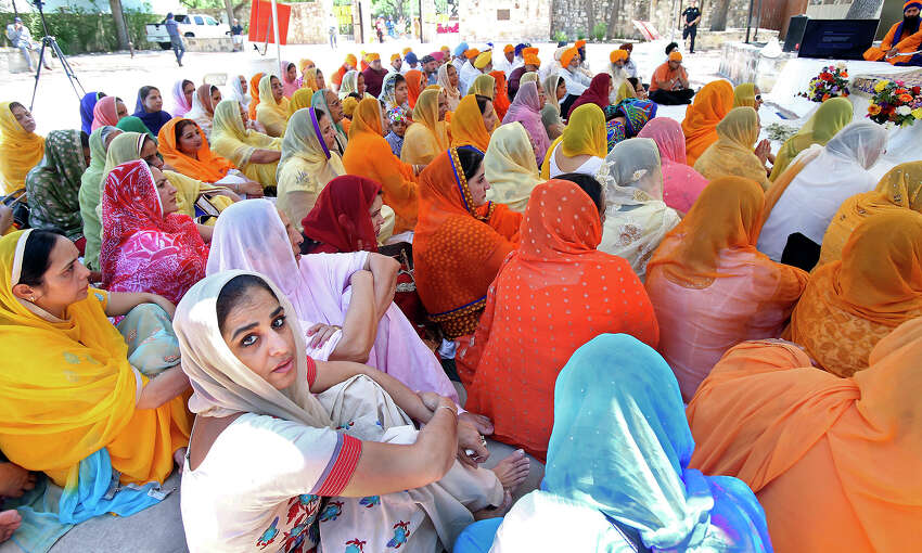 Women pray before the Sikh March for Peace starts at La Villita's Maverick Plaza where an event to raise money for the San Antonio Food Bank is held on May 3, 2014.