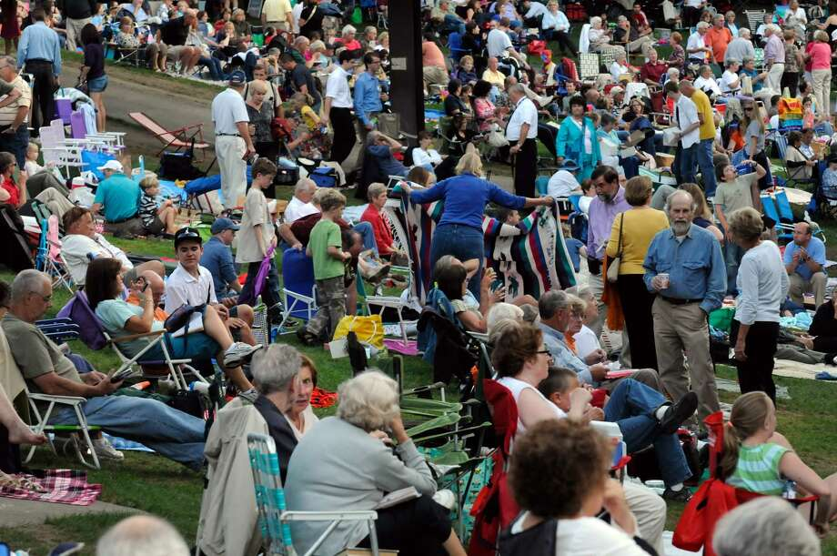 Music lovers pack the lawn during The Philadelphia Orchestra's performance of Broaway to Hollywood at SPAC in  Saratoga Springs, NY Friday Aug. 12,2011.( Michael P. Farrell/Times Union) ORG XMIT: MER2014042216122207 Photo: Michael P. Farrell / 00014266A