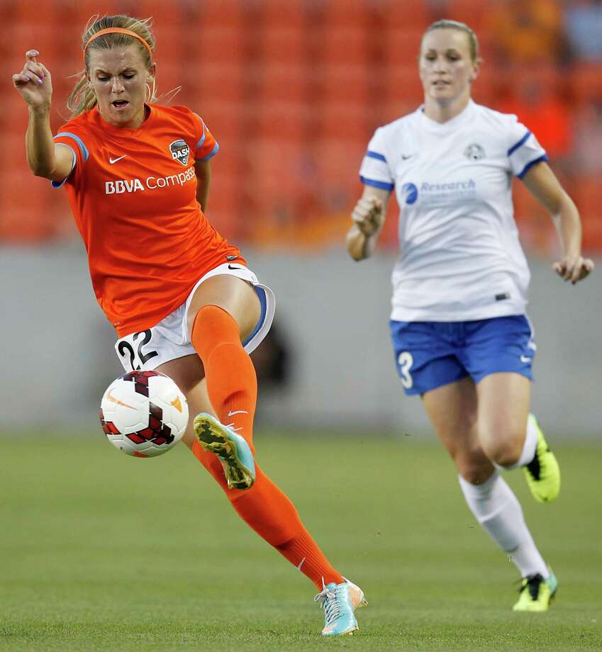 Houston Dash Stephanie Ochs (22) kicks the ball away from FC Kansas City Leigh Ann Robinson (13) in the first half on May 3, 2014 at BBVA Compass Stadium in Houston, TX. Photo: Thomas B. Shea, For The Chronicle / © 2014 Thomas B. Shea
