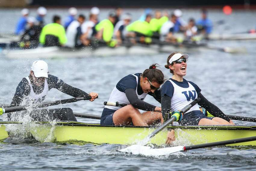 The University of Washington Women's 8 crosses the finish line to win the Women's Windermere Cup during the annual Windermere Cup Regatta and official kickoff of the boating season on Saturday, May 3, 2014. Rowing teams competed in the regatta and a parade of boats welcomed another official season of boating.
