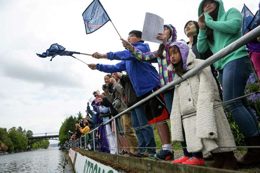 Hyunsu Lee, in blue, waves flags as Rachel So, 6, watches the action during the annual Windermere Cup Regatta.
