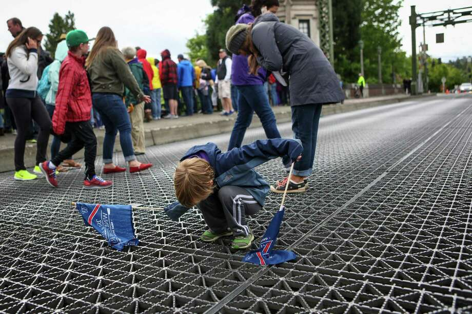 Mason Foster, 5, watches boats pass under the Montlake Bridge during the annual Windermere Cup Regatta. Photo: JOSHUA TRUJILLO, SEATTLEPI.COM / SEATTLEPI.COM