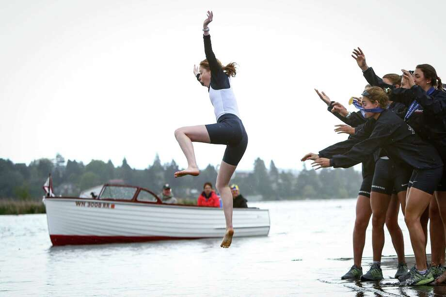 University of Washington Women's coxswain Madeline Johnston is tossed into the water by teammates after winning the Women's Windermere Cup. Photo: JOSHUA TRUJILLO, SEATTLEPI.COM / SEATTLEPI.COM