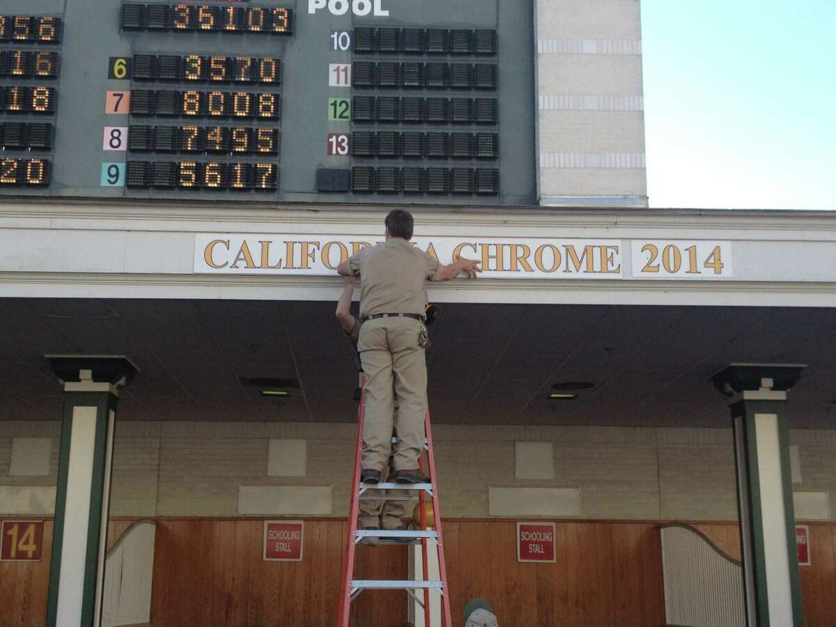 The Kentucky Derby results were less than a half-hour old when the crew at Churchill Downs went to work. California Chrome, the newest member of the Derby winners' club, was having his name put in the special spot above the saddling area in the paddock. Orb, the 2013 winner, had his name removed, and California Chrome will have his name there for a year, reminding everyone of what he did Saturday. (Tim Wilkin / Times Union)