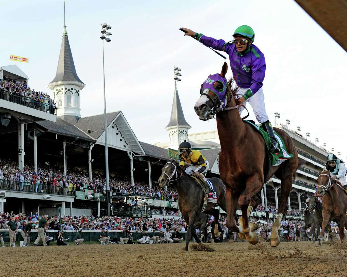 Victor Espinoza is jubilant after winning the 140th running of The Kentucky Derby on California Chrome Saturday evening May 3, 2014 in Louisville, Kentucky (Skip Dickstein / Times Union) ORG XMIT: J=0504_derby