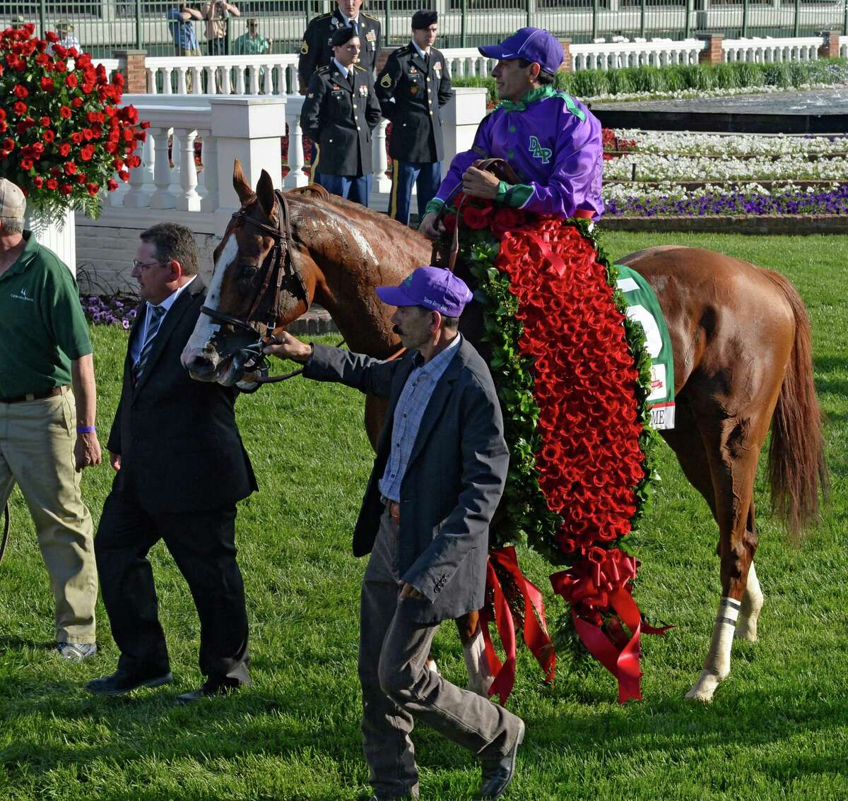 Victor Espinoza rides in to the winner's circle with the blanket of roses after winning the 140th running of The Kentucky Derby aboard California Chrome Saturday evening May 3, 2014 in Louisville, Kentucky (Skip Dickstein / Times Union) ORG XMIT: J=0504_derby