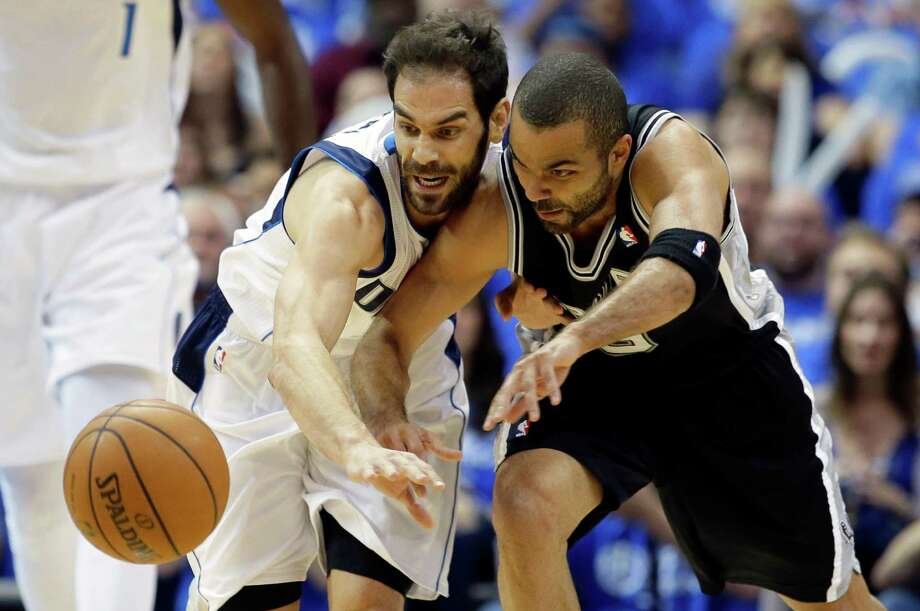 Dallas Mavericks' Jose Calderon, left, of Spain, and San Antonio Spurs' Tony Parker, of France, chase after a loose ball in the first half of Game 6 of an NBA basketball first-round playoff series on Friday, May 2, 2014, in Dallas. (AP Photo/Tony Gutierrez) Photo: Tony Gutierrez, Associated Press / AP