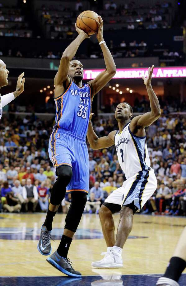 Oklahoma City Thunder forward Kevin Durant (35) shoots ahead of Memphis Grizzlies guard Tony Allen (9) in the second half of Game 6 of an opening-round NBA basketball playoff series Thursday, May 1, 2014, in Memphis, Tenn. Durant led Oklahoma City with 36 points as they won 104-84 to even the series 3-3. (AP Photo/Mark Humphrey) ORG XMIT: TNMH119 Photo: Mark Humphrey / AP