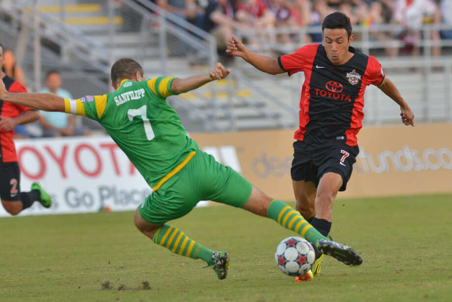 The Scorpions' Walter Restreppo tries to get past Tampa Bay's Frankie Sanfilippo during first-half action Saturday night at Toyota Field in the Rowdies' 1-0 win. Photo: Photos By Robin Jerstad / For The Express-News