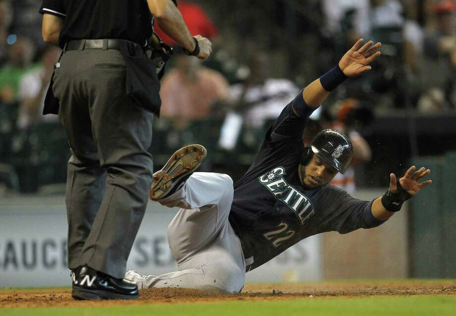 Mariners second baseman Robinson Cano scores on a double hit by Kyle Seager, part of Seattle's eight-run seventh inning Saturday at Minute Maid Park. It was the Mariners' highest-scoring inning since notching eight against the Rangers in 2012. Photo: Karen Warren / Houston Chronicle / © 2014 Houston Chronicle